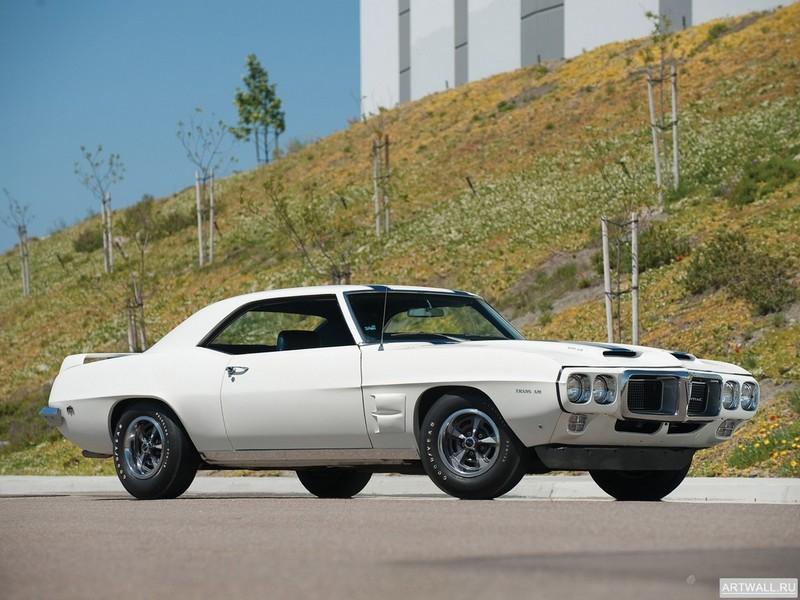 Постер Pontiac Firebird Trans Am 1969, 27x20 см, на бумагеPontiac<br>Постер на холсте или бумаге. Любого нужного вам размера. В раме или без. Подвес в комплекте. Трехслойная надежная упаковка. Доставим в любую точку России. Вам осталось только повесить картину на стену!<br>