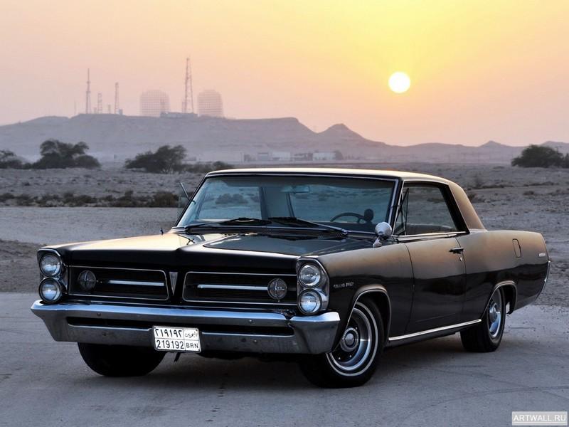 Постер Pontiac Grand Prix 1963, 27x20 см, на бумагеPontiac<br>Постер на холсте или бумаге. Любого нужного вам размера. В раме или без. Подвес в комплекте. Трехслойная надежная упаковка. Доставим в любую точку России. Вам осталось только повесить картину на стену!<br>