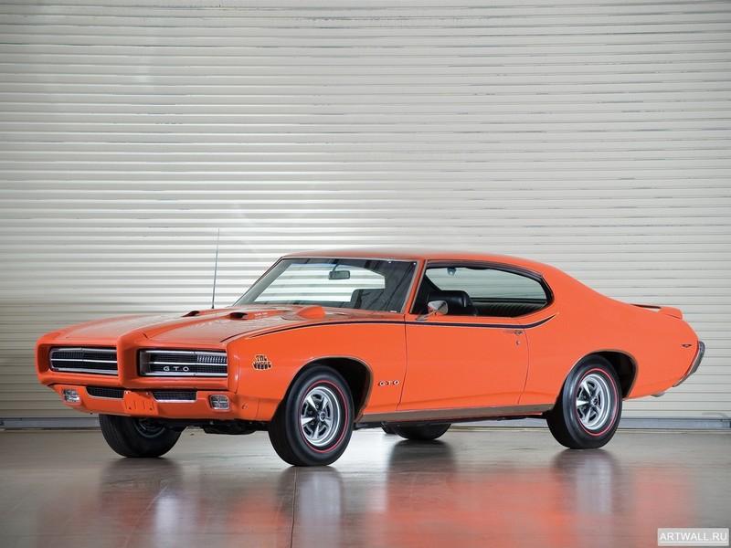 Постер Pontiac GTO The Judge Hardtop Coupe 1969 Произведено 6725 единиц, 27x20 см, на бумагеPontiac<br>Постер на холсте или бумаге. Любого нужного вам размера. В раме или без. Подвес в комплекте. Трехслойная надежная упаковка. Доставим в любую точку России. Вам осталось только повесить картину на стену!<br>
