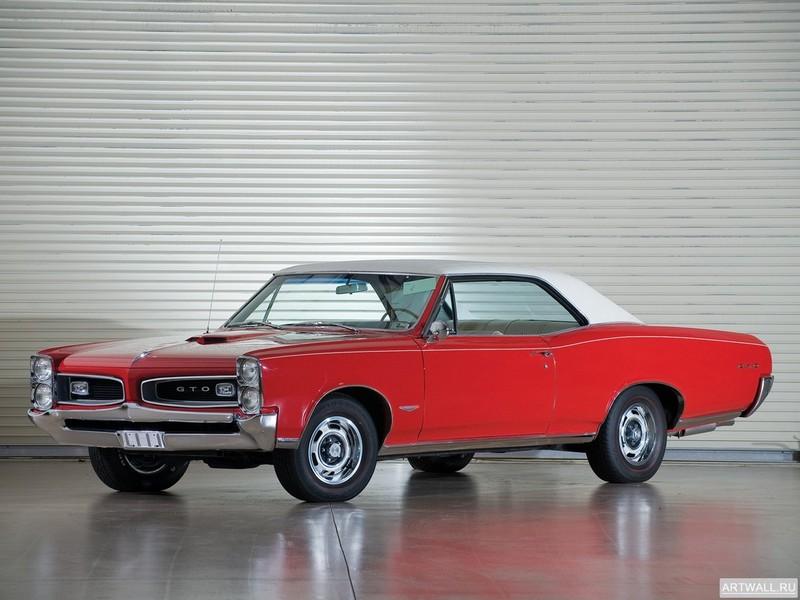 Постер Pontiac GTO Coupe Hardtop 1966, 27x20 см, на бумагеPontiac<br>Постер на холсте или бумаге. Любого нужного вам размера. В раме или без. Подвес в комплекте. Трехслойная надежная упаковка. Доставим в любую точку России. Вам осталось только повесить картину на стену!<br>