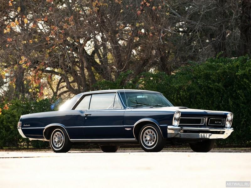 Постер Pontiac Tempest LeMans GTO Hardtop Coupe 1965 Произведены 55722 единицы, 27x20 см, на бумагеPontiac<br>Постер на холсте или бумаге. Любого нужного вам размера. В раме или без. Подвес в комплекте. Трехслойная надежная упаковка. Доставим в любую точку России. Вам осталось только повесить картину на стену!<br>