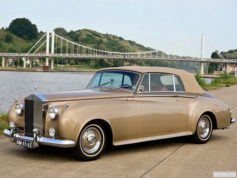 Постер Rolls-Royce Silver Cloud Drophead Coupe (II) 1959-62, 27x20 см, на бумагеRolls-Royce<br>Постер на холсте или бумаге. Любого нужного вам размера. В раме или без. Подвес в комплекте. Трехслойная надежная упаковка. Доставим в любую точку России. Вам осталось только повесить картину на стену!<br>