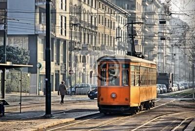 """Постер Города и карты """"Старые винтажные оранжевый трамвай на улице Милан, Италия"""", 30x20 см, на бумаге от Artwall"""