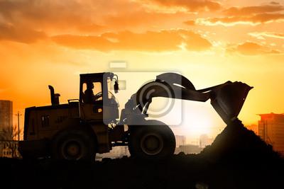 """Постер """"Тяжелый колесный экскаватор машину, работающую на закате"""", 30x20 см, на бумаге от Artwall"""