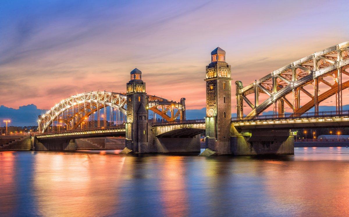 """Постер Города и карты """"Большеохтинский мост на закате больше"""", 32x20 см, на бумаге от Artwall"""